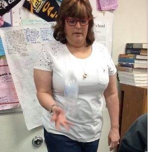 Mrs. Nichter flips a water bottle.