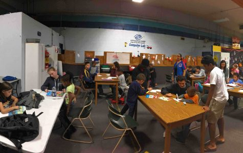 Students read to and help write stories with the members of the Boys and Girls Club.